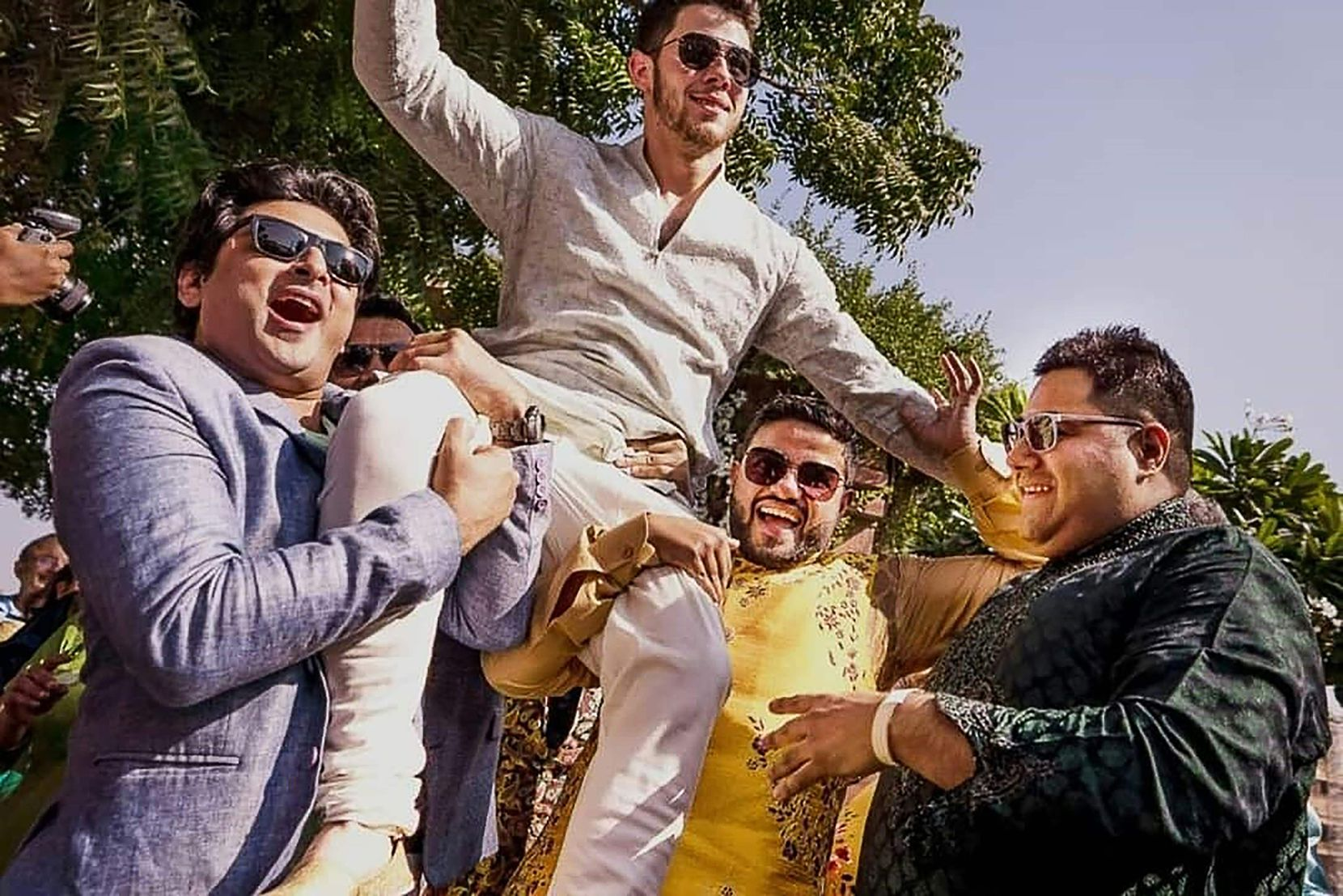 This handout photo released by Raindrop Media shows a dancing Nick Jonas being carried by friends during his wedding celebration at Umaid Bhawan palace in Jodhpur.