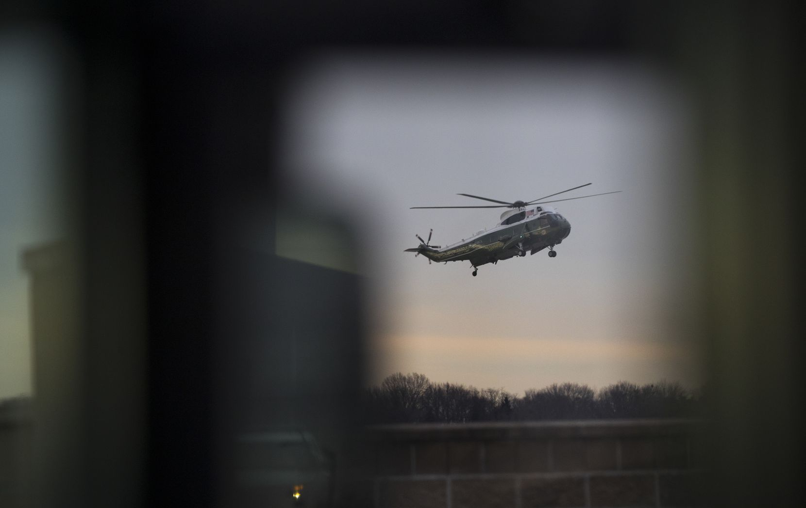 Marine One, carrying President Donald Trump, arrives at Dover Air Force Base to be present as the body of Chief Petty Officer William Owens was returned to the U.S., Feb. 1, 2017. The father of Chief Petty Officer Owens criticized the White House this weekend over the mission that killed his son and called for an investigation.
