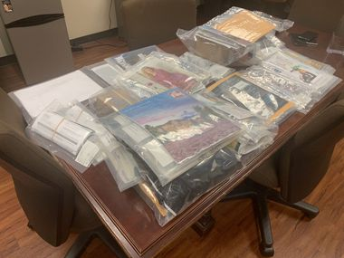 Southlake DPS arrested a man who allegedly had more than 150 pieces of stolen mail, some pictured here, in his vehicle.