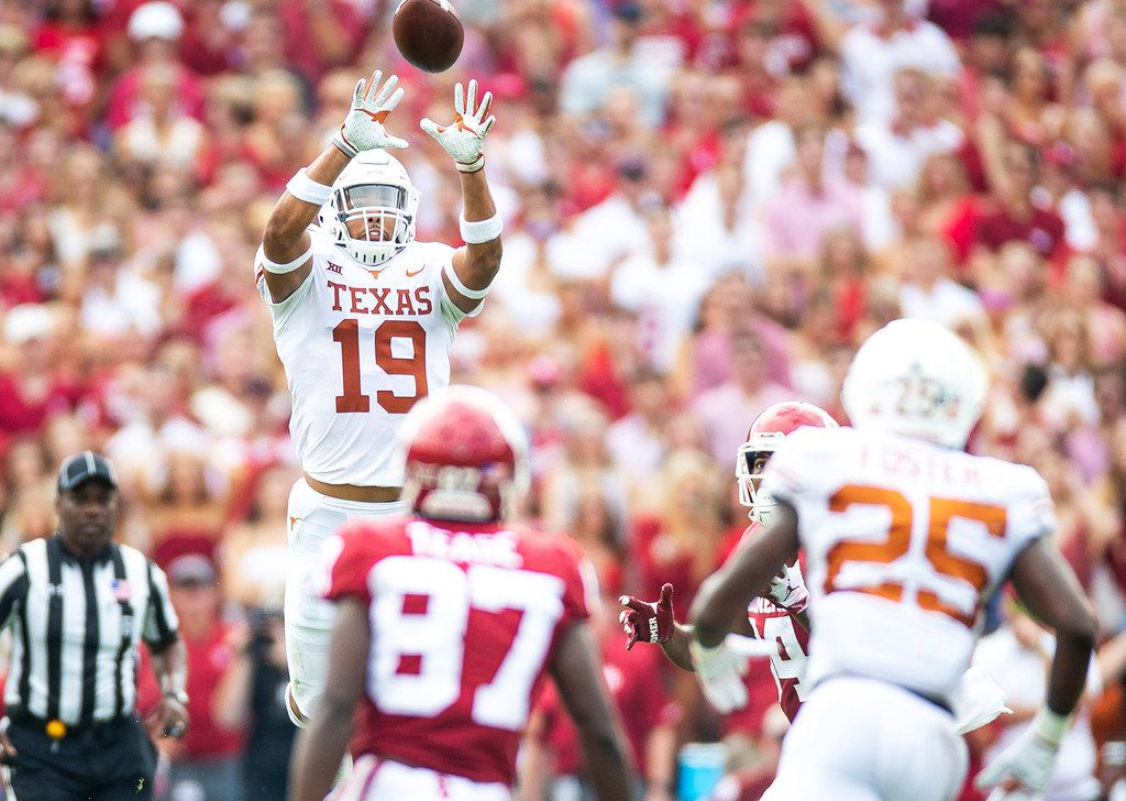 Texas defensive back Brandon Jones (19) intercepts a pass intended for Oklahoma wide receiver Lee Morris (84) during an NCAA college football game at the Cotton Bowl, Saturday, Oct. 6, 2018, in Dallas. (Nick Wagner/Austin American-Statesman via AP)