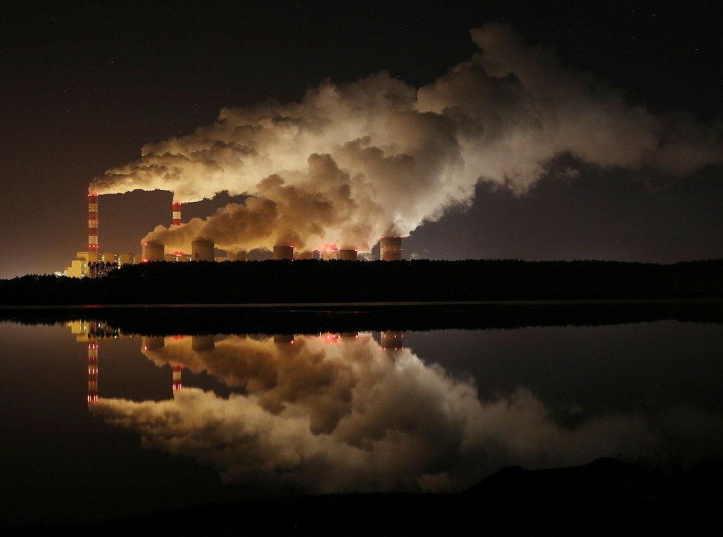 In this Wednesday, Nov. 28, 2018 file photo, clouds of smoke billowed over Europe's largest lignite coal power plant in Belchatow, central Poland.