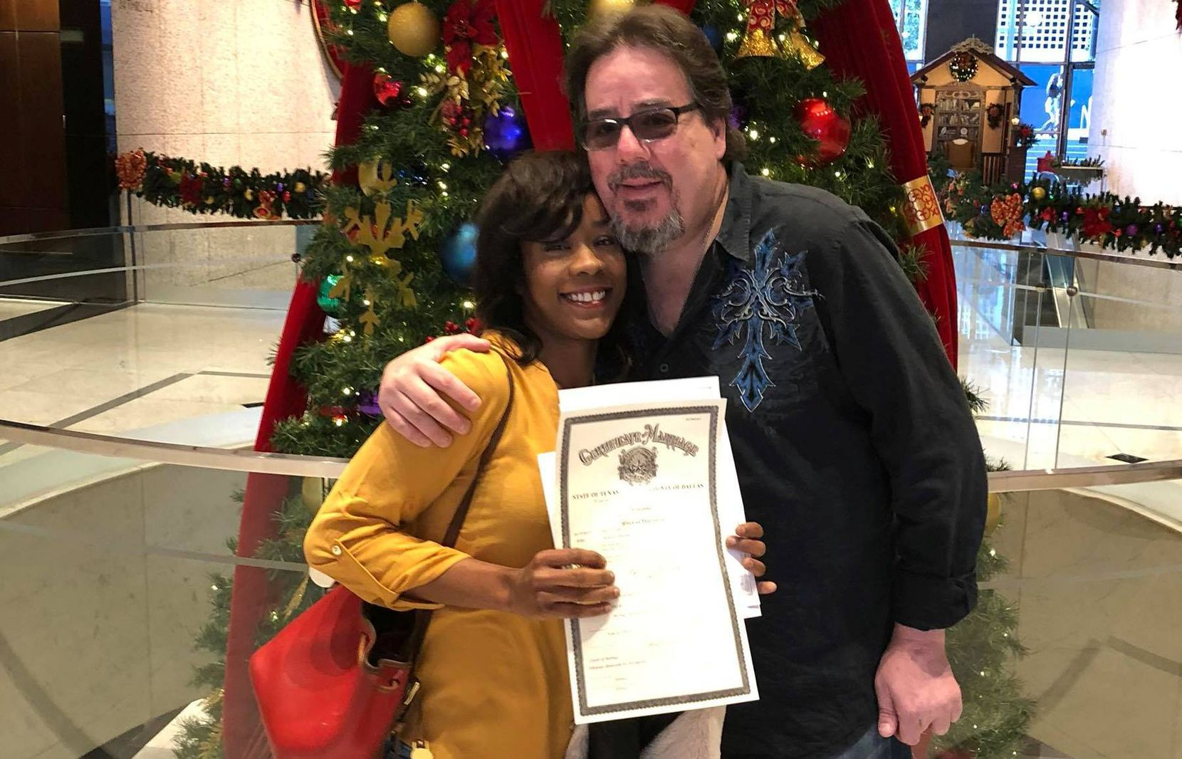 Steven Gentry posted this photo to Facebook of himself and Donnella Heads, holding a marriage certificate. Both were found dead of apparent gunshot wounds in an apartment in the Dallas Love Field area in what police are investigating as a murder-suicide.
