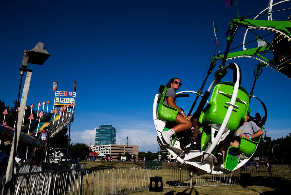 People ride carnival rides during Kaboom Town festivities in Addison, Texas on Tuesday, July 3, 2018. (Ashley Landis/The Dallas Morning News)