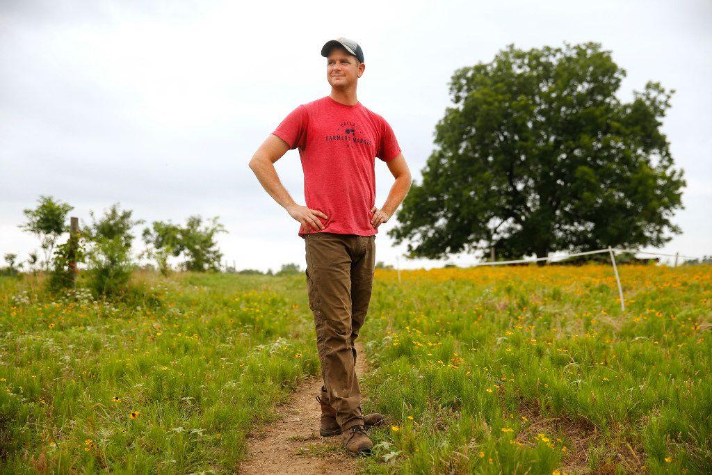 Farmer Thomas Locke walks the third-generation,160-acre  Bois d'Arc farm farm he and his uncle Gordon Locke own in Allens Chapel.