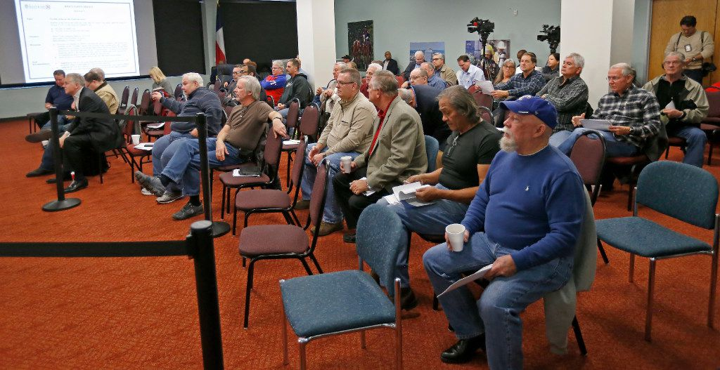 People in the audience attend the Board of Trustees meeting at Dallas Police and Fire Pension System in Dallas, Thursday, Dec. 8, 2016. Members of the Board of Trustees discussed a variety of topics including the possible changes to DROP policy. (Jae S. Lee/The Dallas Morning News)
