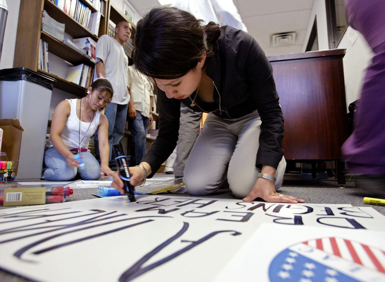 As a sophomore at Yvonne A. Ewell Townview Center in 2006, Girsea Martinez worked on a poster in the days leading up to a massive pro-immigration march in Dallas.