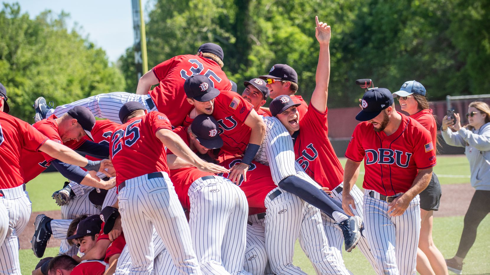Dallas Baptist baseball celebrates its Missouri Valley Conference title on Sunday after defeating Indiana State, 12-8, in 11 innings.