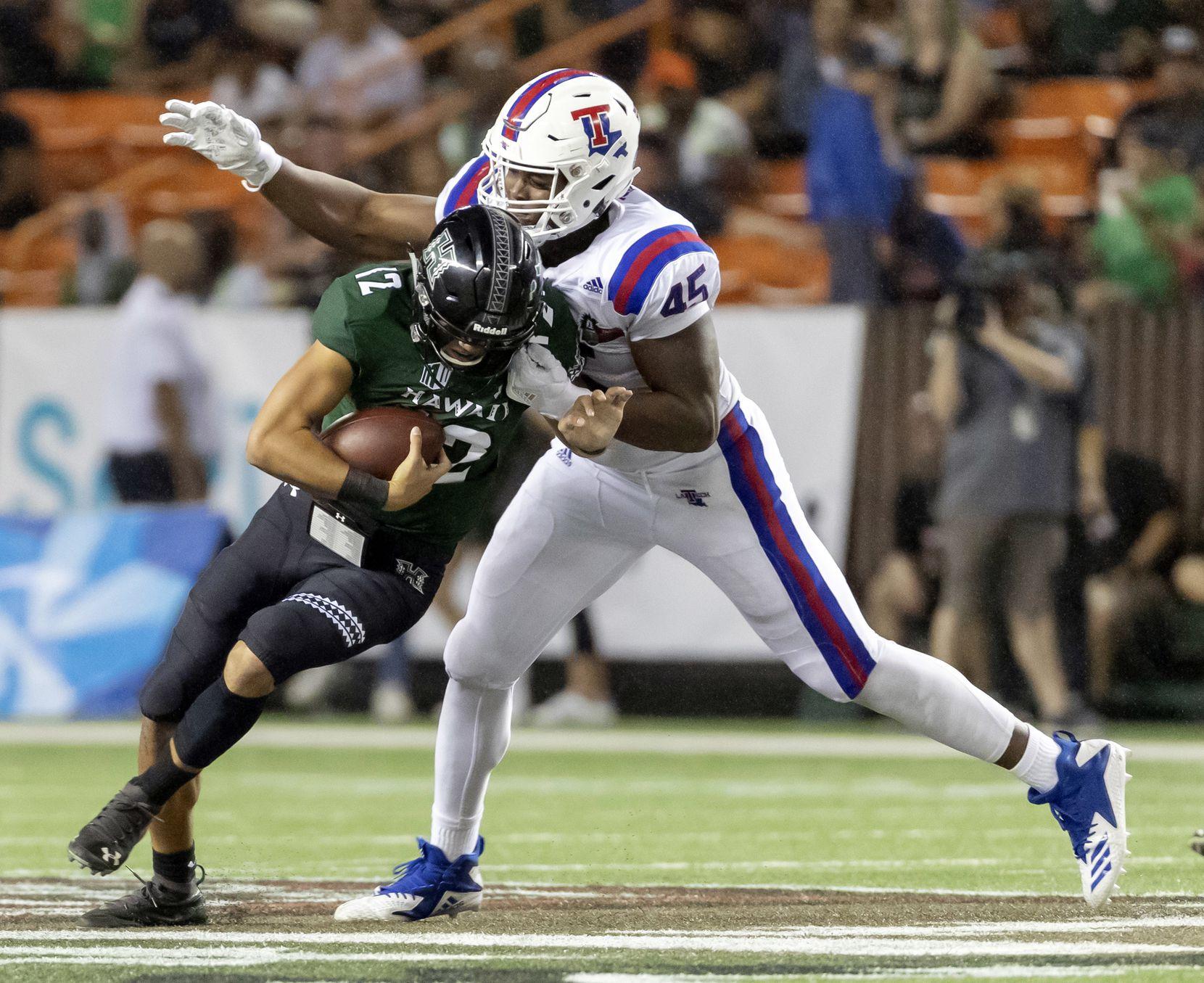 FILE - Louisiana Tech defensive end Jaylon Ferguson (45) sacks Hawaii quarterback Chevan Cordeiro (12) in the first half of the Hawaii Bowl NCAA college football game, Saturday, Dec. 22, 2018, in Honolulu. (AP Photo/Eugene Tanner)