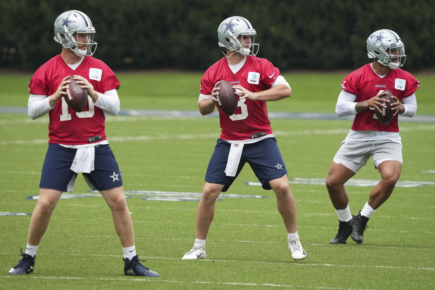 Dallas Cowboys quarterbacks, from left, Cooper Rush, Garrett Gilbert and Dak Prescott participate in a drill during a minicamp practice at The Star on Wednesday, June 9, 2021, in Frisco. (Smiley N. Pool/The Dallas Morning News)