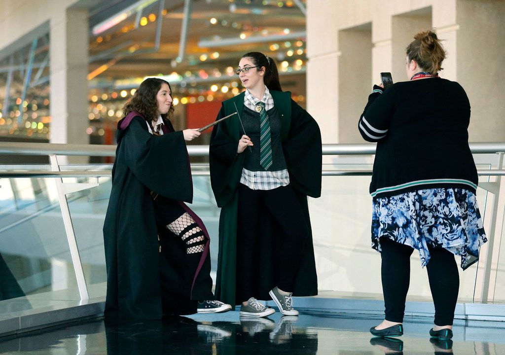 Erin Fitzgerald (left) dressed as Hermione Granger and Katy Fitzgerald dressed as a Slytherin student for LeakyCon Dallas.
