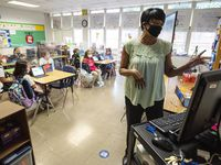 Dallas second graders listen as teacher Michelle Jones conducts a lesson at Tom Gooch Elementary School. Most Texas schools reopened this school year during the pandemic offering a mix of in-person and virtual classes.