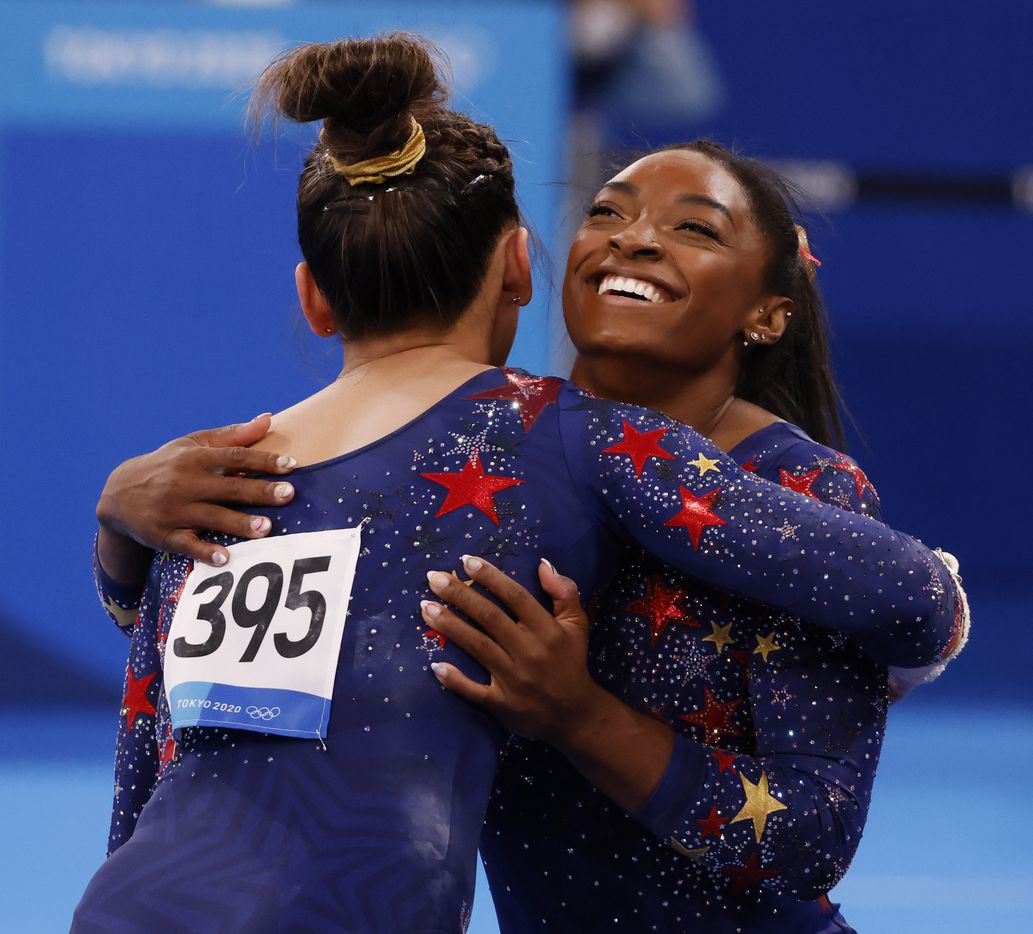 USA's Sunisa Lee hugs Simone Biles after she competed on the uneven bars in a women's gymnastics event during the postponed 2020 Tokyo Olympics at Ariake Gymnastics Centre on Sunday, July 25, 2021, in Tokyo, Japan. (Vernon Bryant/The Dallas Morning News)
