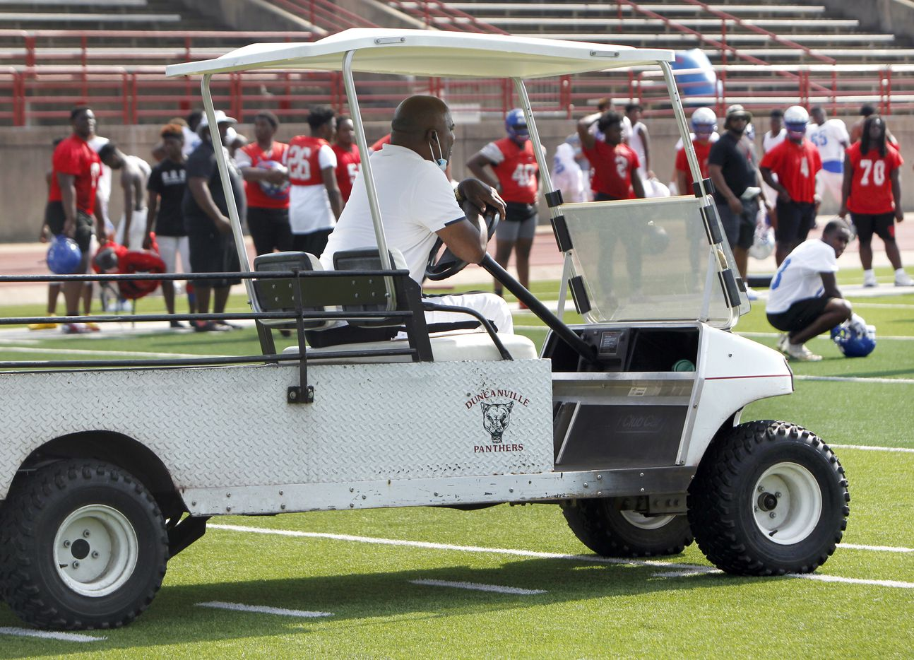 Duncanville panther head football coach Reginald Samples intently observes his varsity squad in the shade from under the canopy of a team utility cart. The Duncanville varsity football team conducted their 2021season football opening practice at Panther Stadium in Duncanville on August 9, 2021. (Steve Hamm/ Special Contributor)