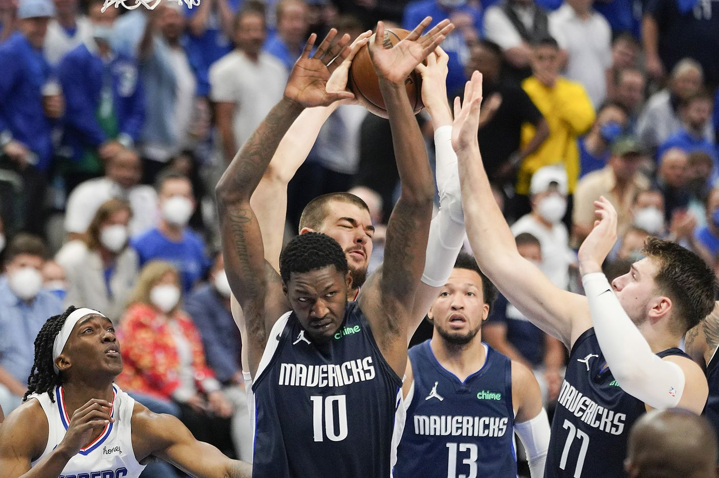 LA Clippers center Ivica Zubac (40) grabs a rebound away from Dallas Mavericks forward Dorian Finney-Smith (10) and guard Luka Doncic (77) during the second half  of an NBA playoff basketball game at American Airlines Center on Friday, May 28, 2021, in Dallas.