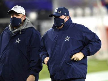 Dallas Cowboys head coach Mike McCarthy, right, leaves the field after an NFL football game against the Baltimore Ravens, Tuesday, Dec. 8, 2020, in Baltimore. The Ravens won 34-17.