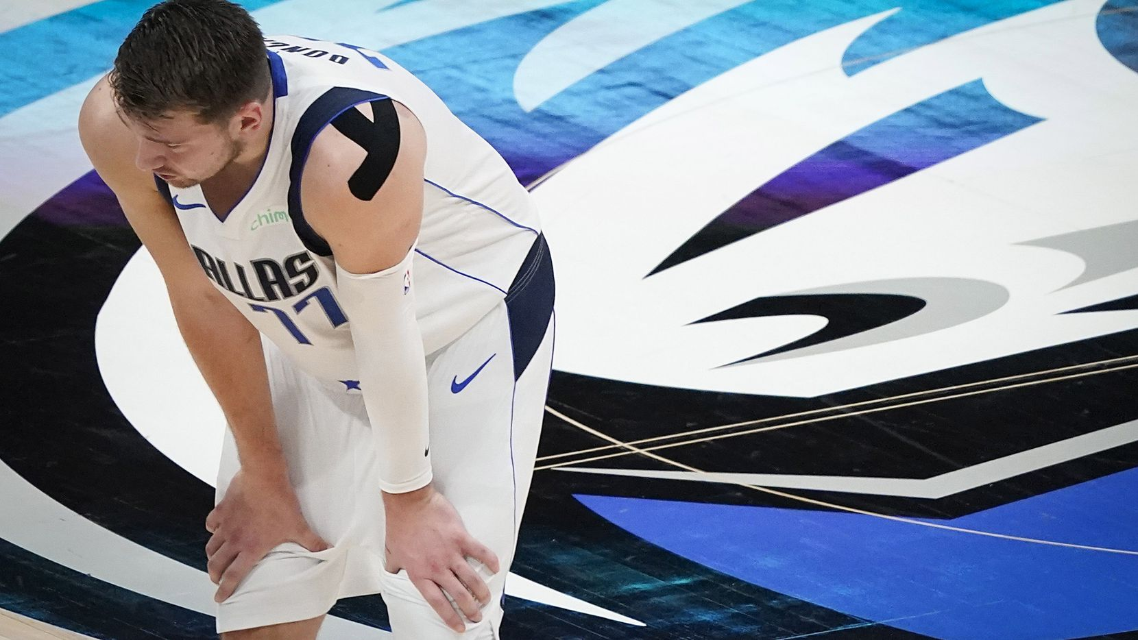 Dallas Mavericks guard Luka Doncic (77) catches his breath during a stop in play during the second quarter of an NBA playoff basketball game against the LA Clippers at American Airlines Center on Sunday, May 30, 2021, in Dallas.