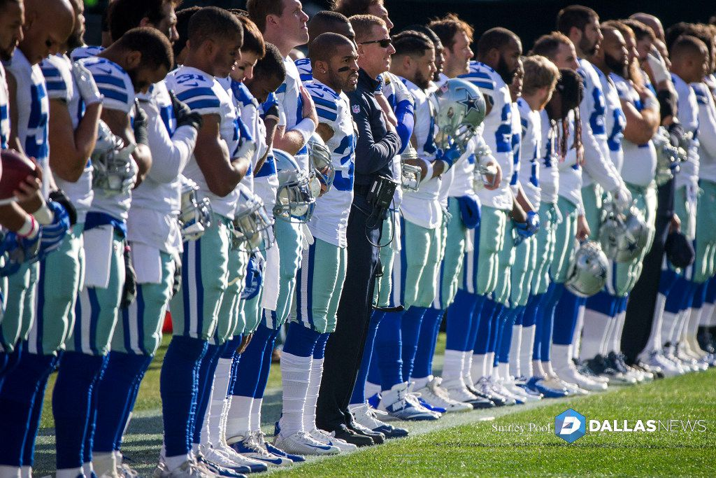 Dallas Cowboys players stand for the national anthem before an NFL football game against the Philadelphia Eagles at Lincoln Financial Field on Sunday, Jan. 1, 2017, in Philadelphia. (Smiley N. Pool/The Dallas Morning News) ORG XMIT: DMN1701011408001945