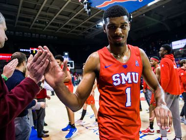 Southern Methodist Mustangs forward Feron Hunt (1) gets high-fives after an NCAA basketball game between SMU and UConn on Wednesday, February 12, 2020 at Moody Coliseum on the SMU campus in Dallas. SMU won 79-75. (Ashley Landis/The Dallas Morning News)