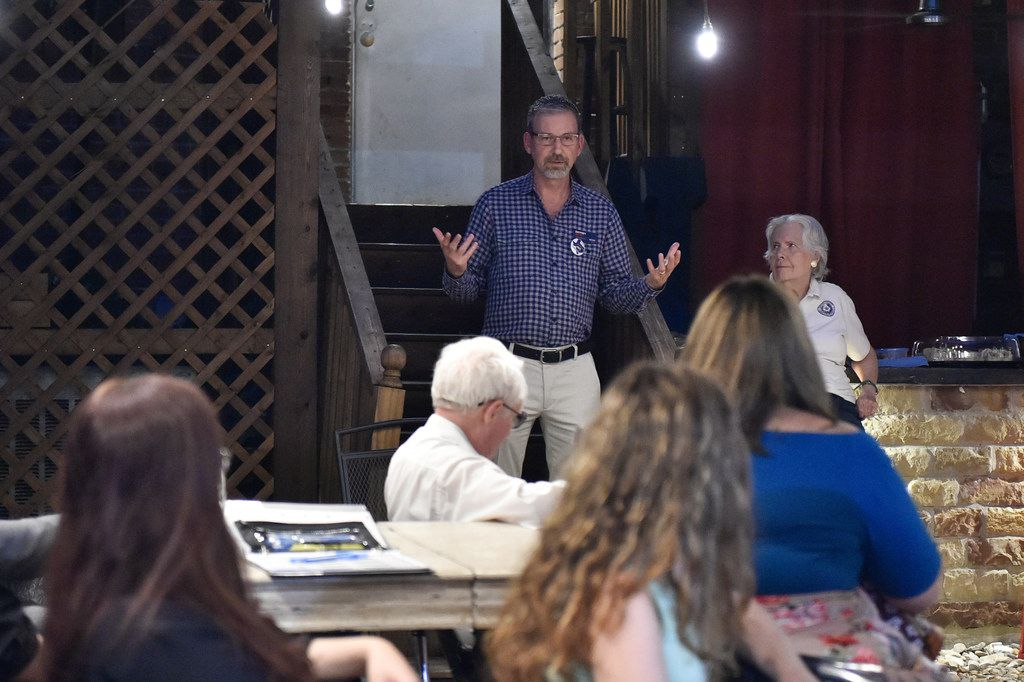 Jeffrey Payne, top, a Democrat running for governor of Texas, speaks to guests at a meeting of the Stonewall Democrats of Denton County at Wine Squared, on Oct. 21, 2017, in Denton.