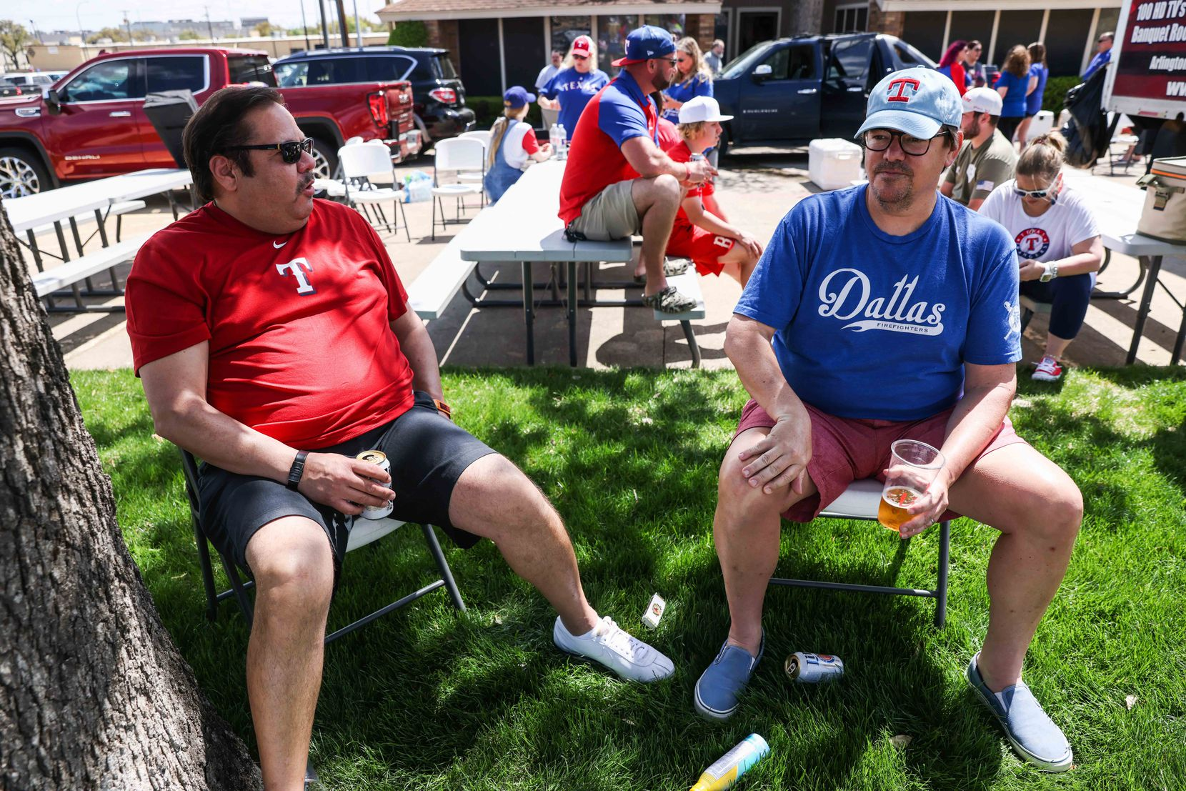 From left John Cantu and Justin Treaster talk about their experience before the game between Texas Rangers and Toronto Blue Jays on opening day outside the Globe Life Field in Arlington, Texas on Monday, April 5, 2021. (Lola Gomez/The Dallas Morning News)