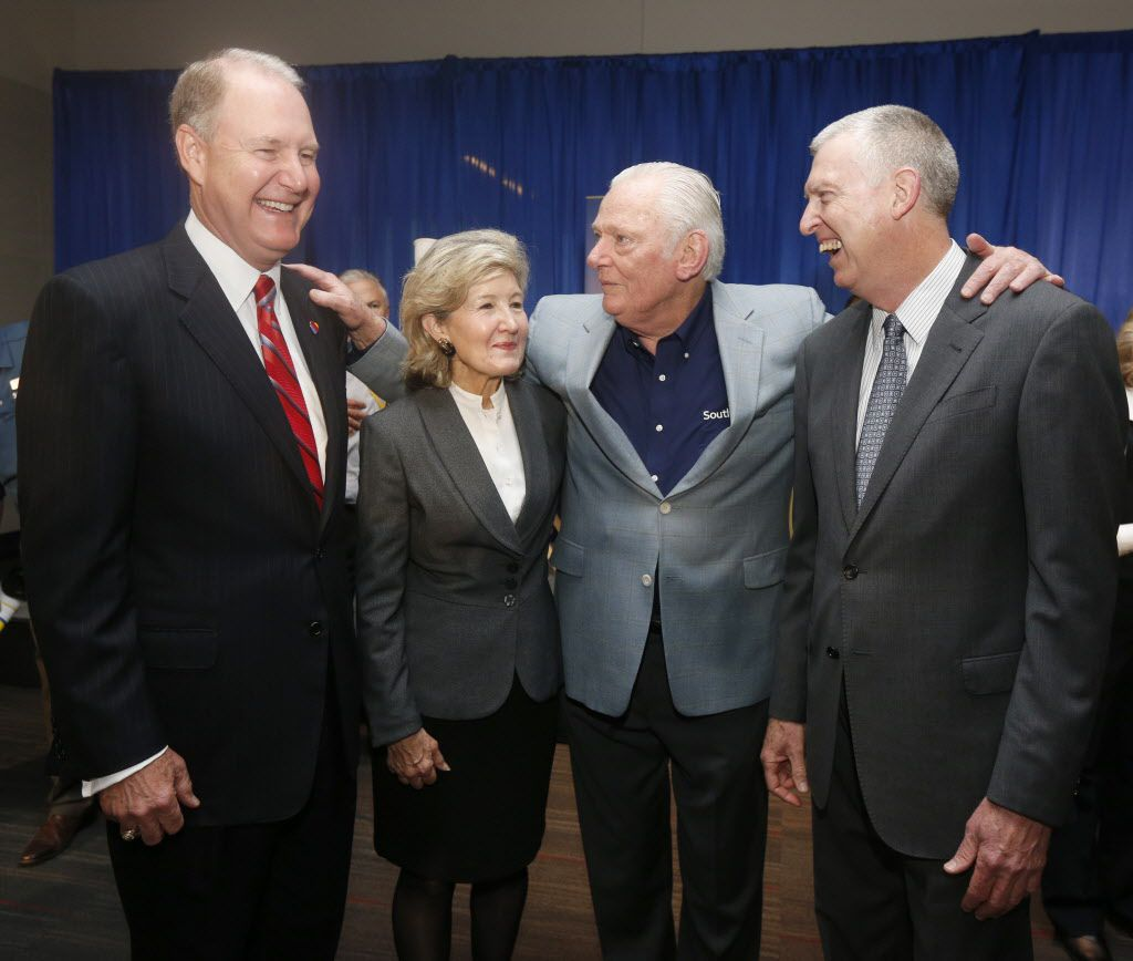 Southwest Airlines chairman and CEO Gary Kelly, former U.S. Sen. Kay Bailey Hutchison, Southwest chairman emeritus Herb Kelleher and Southwest executive vice president Ron Ricks, celebrate the end of the Wright amendment at an Oct. 13, 2014, event at Dallas Love Field. (Michael Ainsworth, staff photographer)