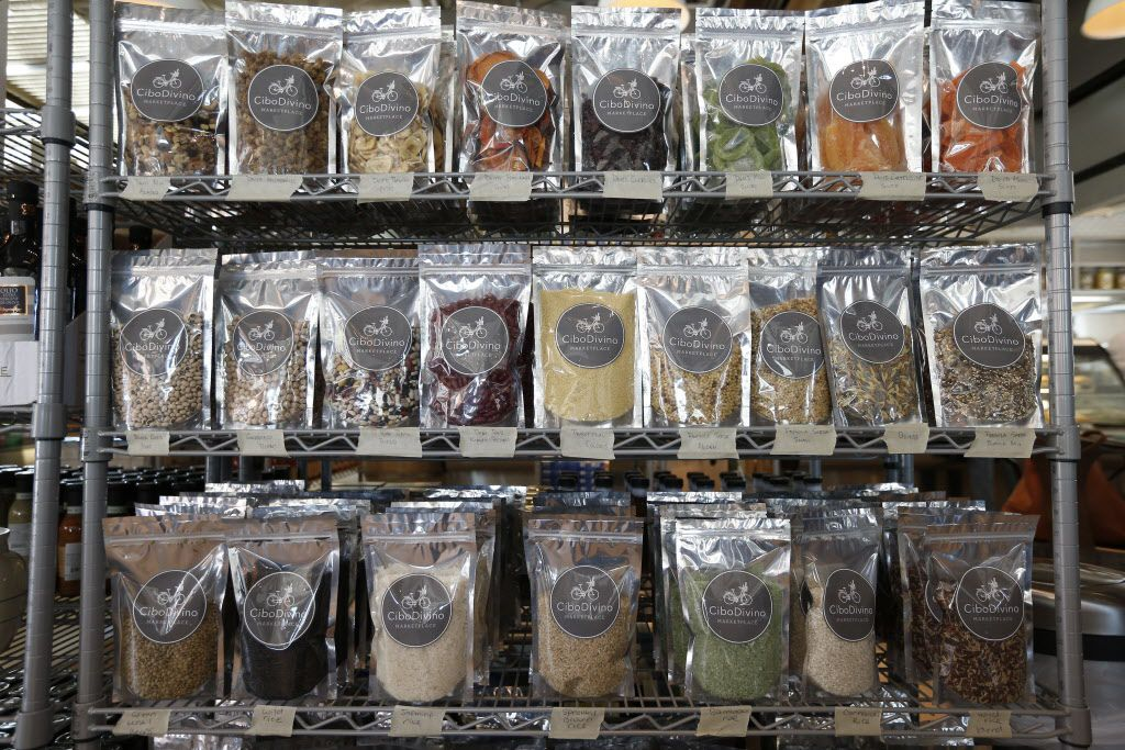 Assorted private label snacks and spices at Cibo Divino, Friday, May 1, 2015. (Brandon Wade/Special Contributor)