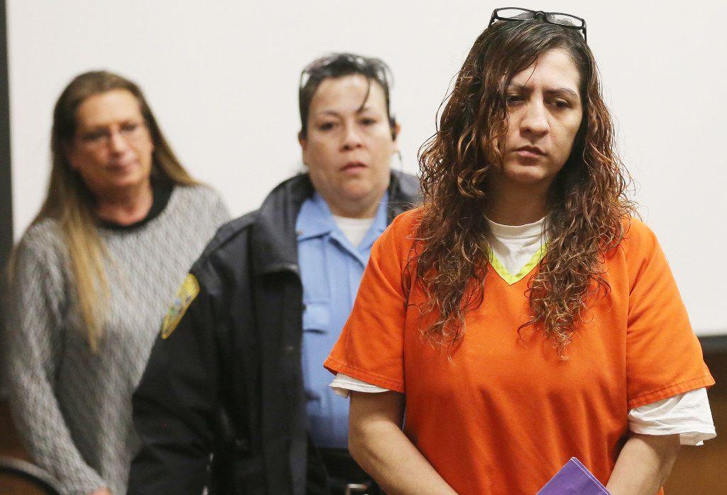 Yesenia Sesmas returns to court after a break in a preliminary hearing Thursday. (Bo Rader/Wichita Eagle)