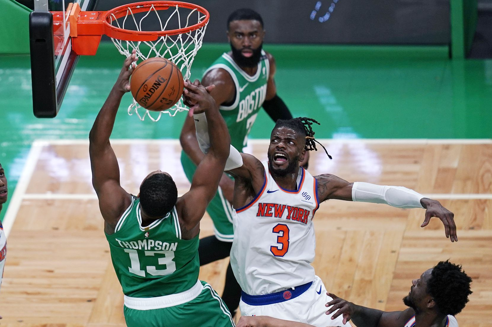New York Knicks center Nerlens Noel (3) blocks a shot by Boston Celtics center Tristan Thompson (13) during the first half of an NBA basketball game Wednesday, April 7, 2021, in Boston.