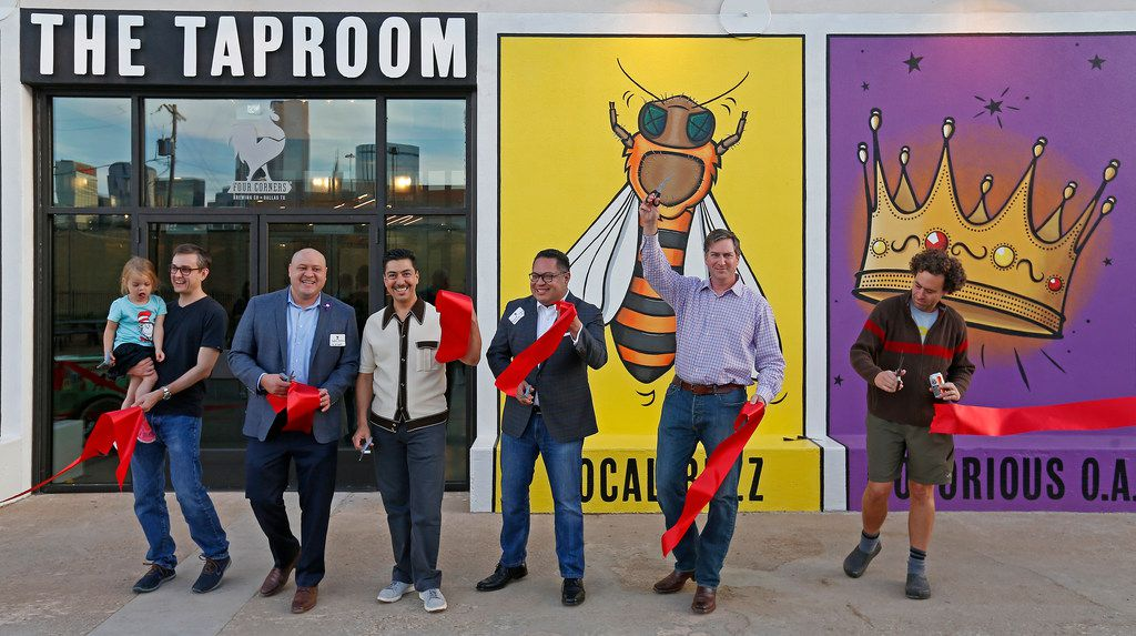City officials and Four Corners Brewing Co. owners celebrate after they cut a ribbon at the Four Corners Brewing Company's new facility in the Cedars neighborhood in Dallas Oct. 18, 2017.