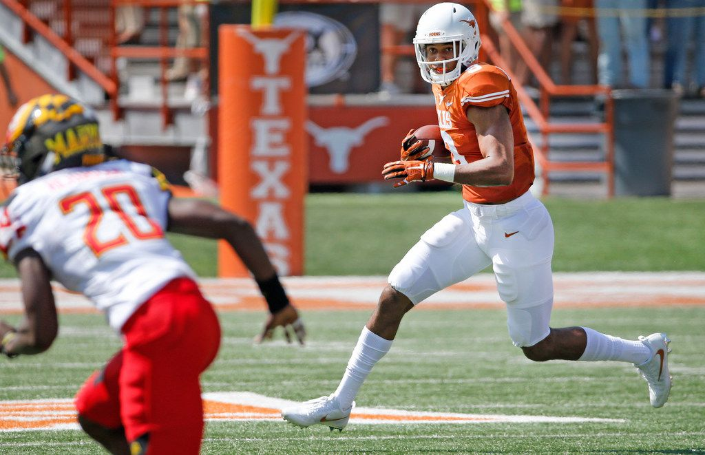 Texas Longhorns wide receiver Collin Johnson (9) runs for yardage after a pass catch during the University of Maryland Terrapins vs. the University of Texas Longhorns NCAA football game at Darrell K Royal Texas Memorial Stadium in Austin, Texas on Saturday, September 2, 2017. (Louis DeLuca/The Dallas Morning News)