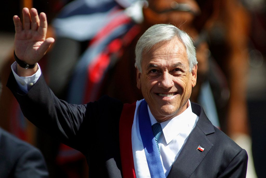 Chilean President Sebastián Piñera waves as he arrives at the metropolitan cathedral in Santiago to attend the ecumenical ceremony offered by the Catholic Church on March 12. A conservative billionaire, Piñera was sworn in March 11 to his second term as president of Chile, replacing socialist Michelle Bachelet.