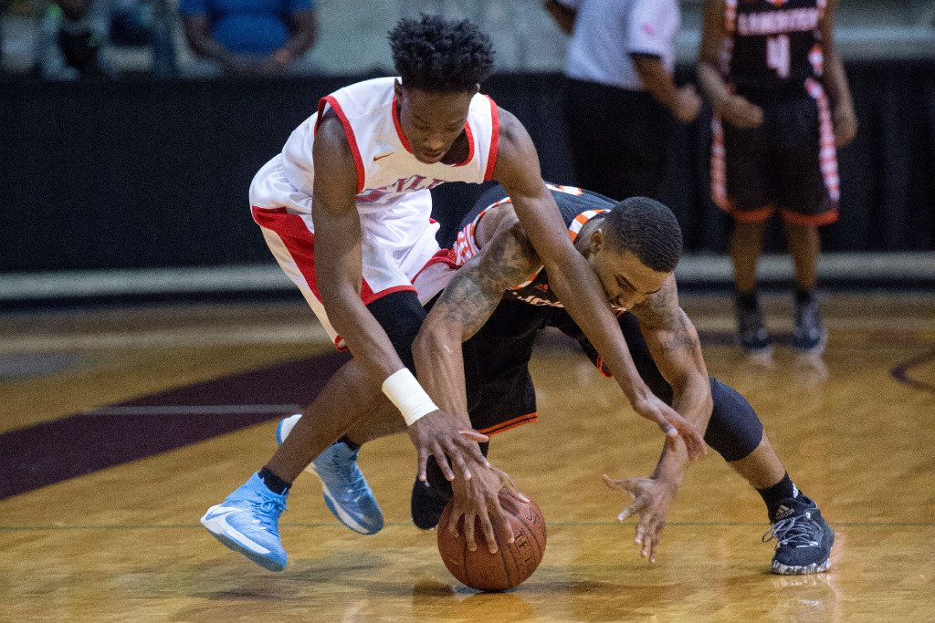 Skyline senior guard Marcus Garrett (23) and Lancaster senior guard T.J. Starks (2) battle for a loose ball in the second quarter of their semifinal game in the Dallas ISD Holiday Invitational high school basketball tournament on Thursday, December 29, 2016 at Ellis Davis Field House in Dallas. (Jeffrey McWhorter/Special Contributor)