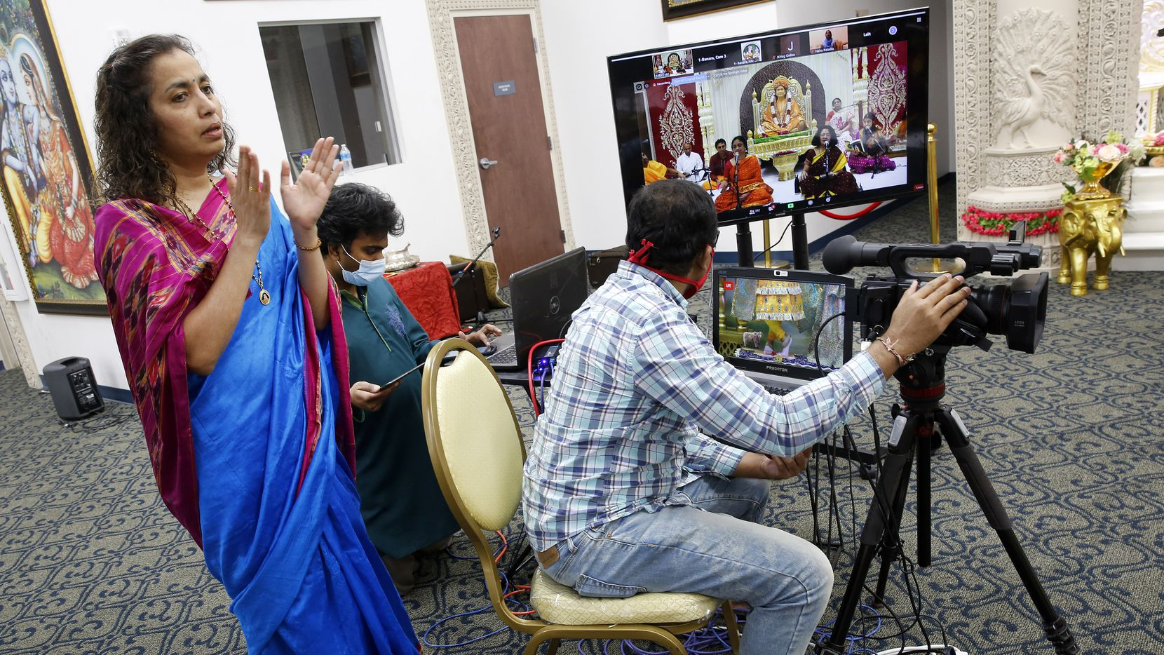 Temple president Shreya Bhat sings along as a live broadcast of Bhoomi Poojan, a three-day ceremony of praying, singing and chanting at the Radha Krishna Temple of Dallas in Allen, Texas, Friday, May 15, 2020. (Tom Fox/The Dallas Morning News)