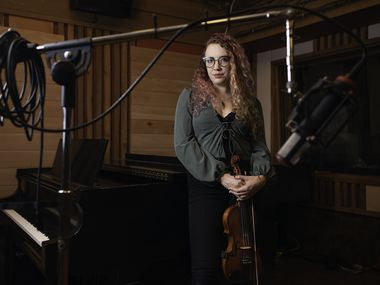 Musician Scarlett Deering, 29, at Acoustic Kitchen Recording Studio in Dallas, March 17, 2020. Deering was booked to perform in the string section of the recently canceled Eagles tour. She is now struggling for work with the recent shutdown of bars and restaurants in Dallas due to COVID-19 virus. Ben Torres/Special Contributor