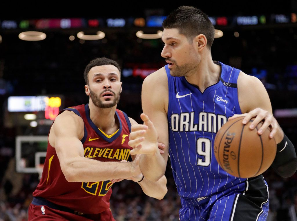 Orlando Magic's Nikola Vucevic (9), from Montenegro, drives past Cleveland Cavaliers' Larry Nance Jr. (22) in the second half of an NBA basketball game, Sunday, March 3, 2019, in Cleveland. The Cavaliers won 107-93. (AP Photo/Tony Dejak)