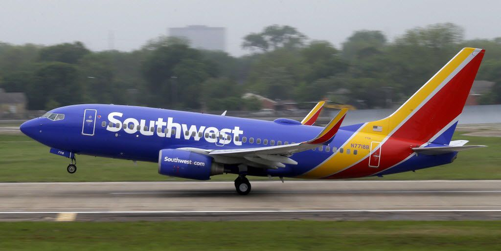 In this April 23, 2015, file photo, a Southwest airlines jet takes off from a runway at Love Field in Dallas. Southwest Airlines is asking travelers on Sunday, Oct. 11, to arrive at least two hours before their scheduled departures as technical issues are forcing it to check-in some customers manually.