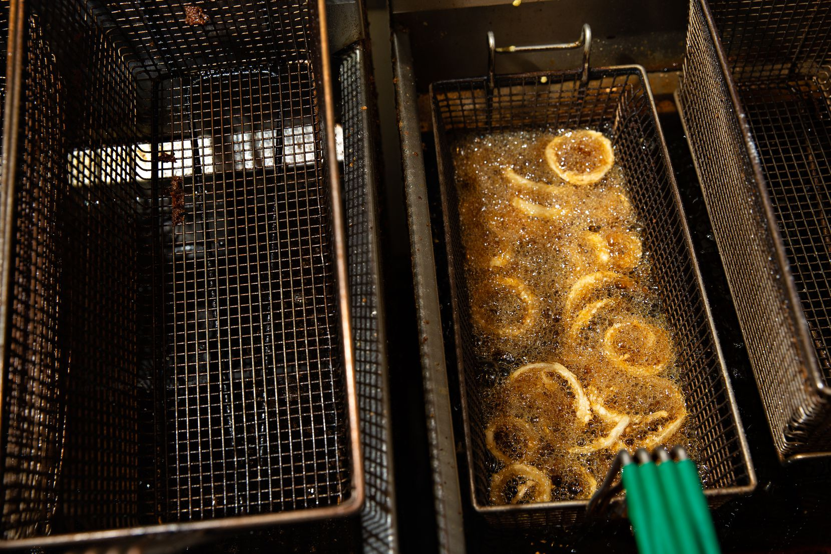 A batch of onion rings are fried to be served at Lakewood Landing in Dallas.