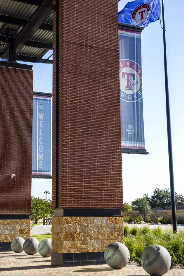 Piers supporting parts of Globe Life Field feature Texas stone, a connecting course of black steel, and red brick, seen outside the southeast entry of the new home of the Texas Rangers, in Arlington, Texas, on  Oct. 14, 2020.