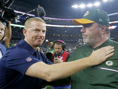 In this Jan. 15, 2017, photo, Dallas Cowboys coach Jason Garrett, left, congratulates Green Bay Packers coach Mike McCarthy after their 34-31 win in an NFL divisional playoff football game in Arlington, Texas. AP Photo/Tony Gutierrez, File)