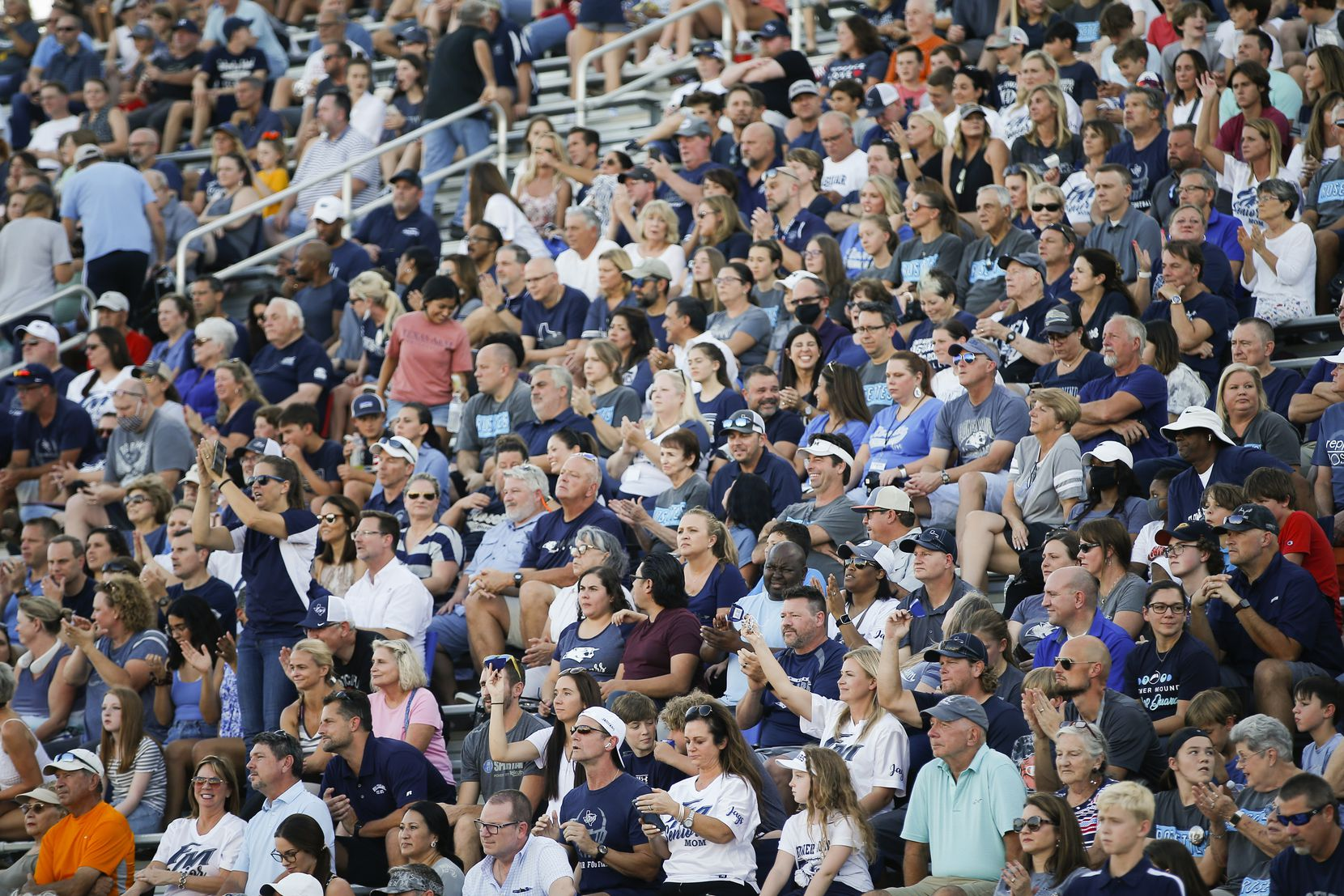 Flower Mound football fans cheer  during the first half of a high school football game at Flower Mound High School, Friday, August 27, 2021. (Brandon Wade/Special Contributor)