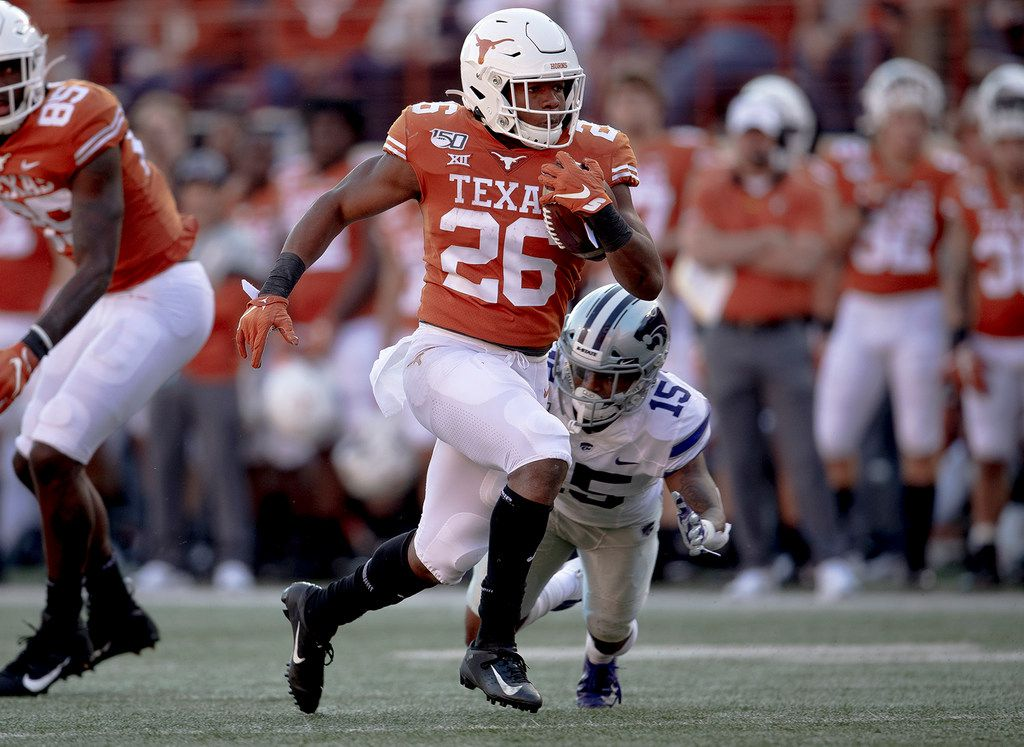 Texas running back Keaontay Ingram (26) runs for a touchdown against Kansas State during an NCAA college football game Saturday, Nov. 9, 2019, in Austin, Texas. (Nick Wagner/Austin American-Statesman via AP)