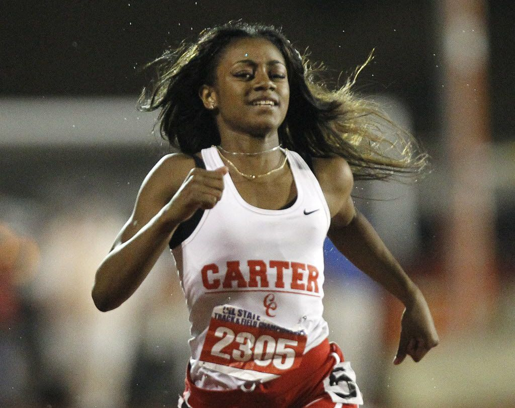 Dallas Carter's Sha'Carri Richardson competes in the class 4A girls 200-meter dash during the UIL Track and Field State Championships in Austin, Saturday, May 14, 2016.  (Stephen Spillman/Special Contributor)