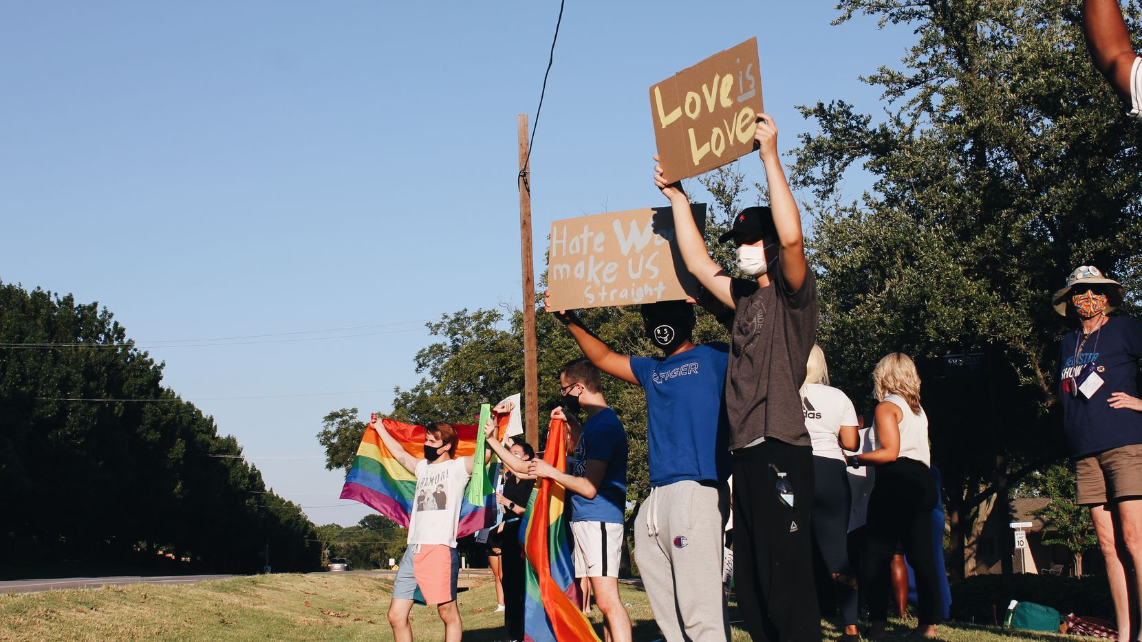 Protestors gather outside of Covenant Christian Academy in Colleyville on Aug. 20, 2020 to speak out against the school's stance on sexuality and the dismissal of Devin Bryant, a gay student.
