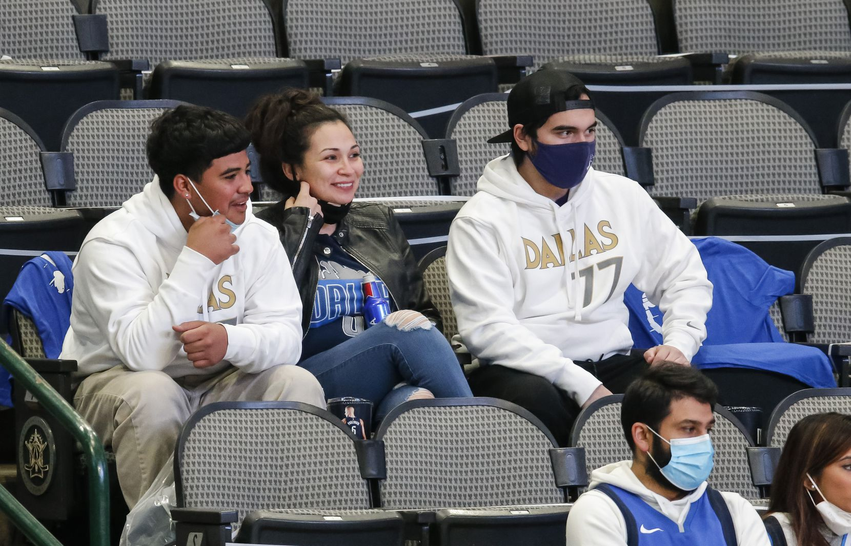 Parkland nurse Heather Lopez, center, watches the Dallas Mavericks take on the Atlanta Hawks during the first half of an NBA basketball game in Dallas, Wednesday, February 10, 2021. (Brandon Wade/Special Contributor)
