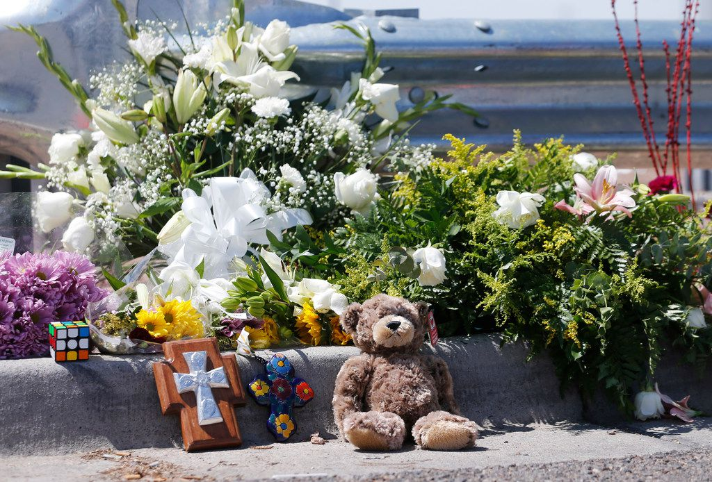 Flowers and other items were left near an entrance to the Walmart where the massacre happened.