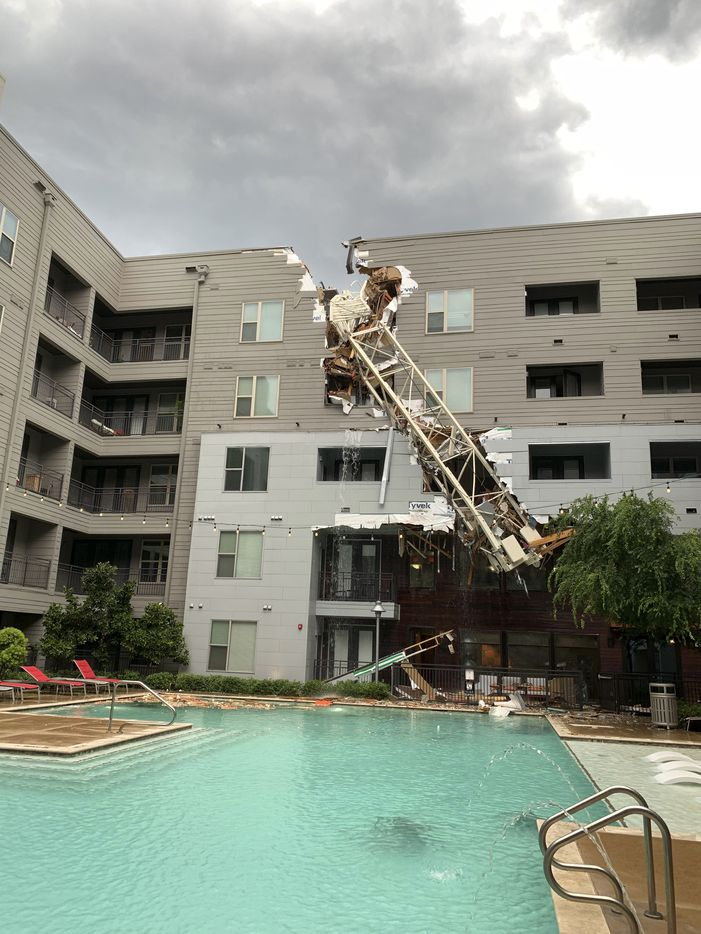Injuries were reported after a crane fell into the Elan City Lights apartment building in Old East Dallas close to downtown, as a severe storm passed through Dallas on Sunday afternoon, June 9, 2019.