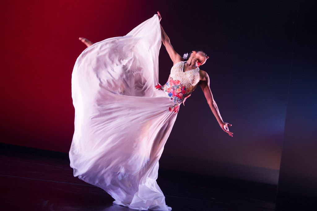 A central figure in Ballet Hispánico's Con Brazos Abiertos represents choreographer Michelle Manzanales' point of view growing up Mexican-American in Houston. (Paula Lobo)