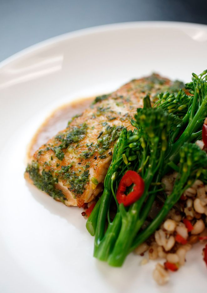 Citrus and basil marinated Atlantic salmon with farro ragout, broccolini and scallion coulis, from the kosher kitchen.
