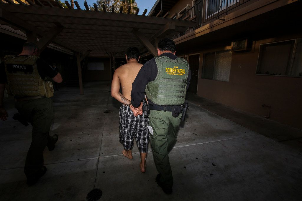 An ICE Enforcement and Removal Operations unit raid to apprehend immigrants without any legal status and who may be deportable on Aug. 12, 2015 in Riverside, Calif.