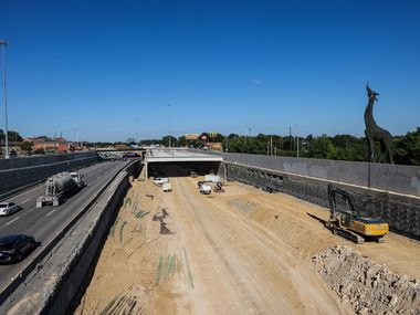 Construction of a Southern Gateway park, a deck park across Interstate 35 at the Dallas Zoo in Dallas on September 23, 2021. (Lola Gomez/The Dallas Morning News)